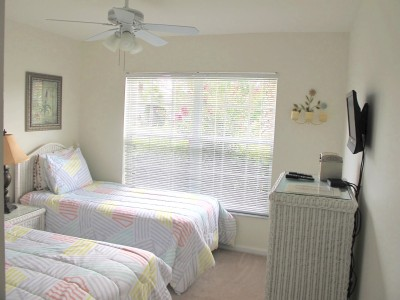 Bright sunny twin white wicker room